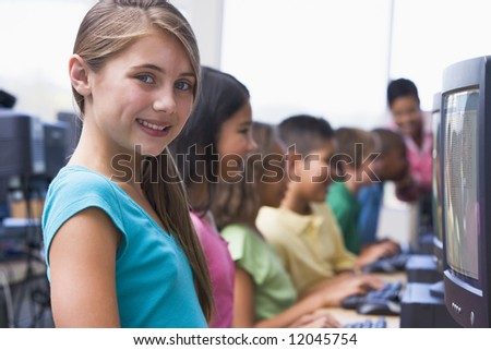 Female pupil in elementary school computer class