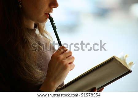 Female reading a book, closeup, background - stock photo