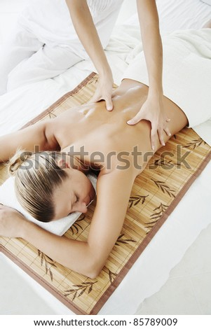 female ready for massage or other wellness treatment - stock photo