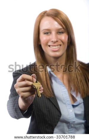 Female real estate agent giving a home buyer the keys to there new home - stock photo