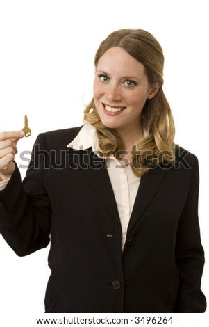 Female realtor holding key isolated on a white background