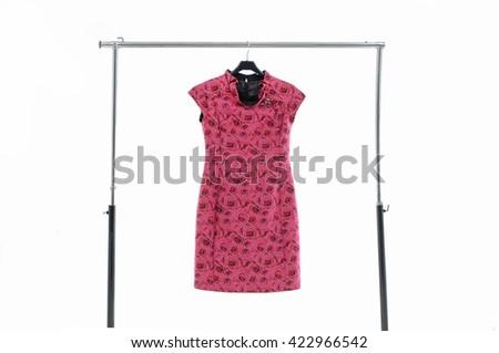 Female red clothing on hanging  - stock photo