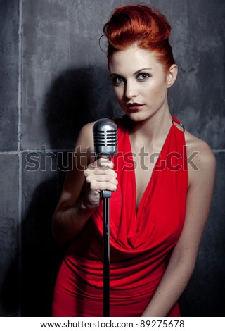 Female redhair singer red dress