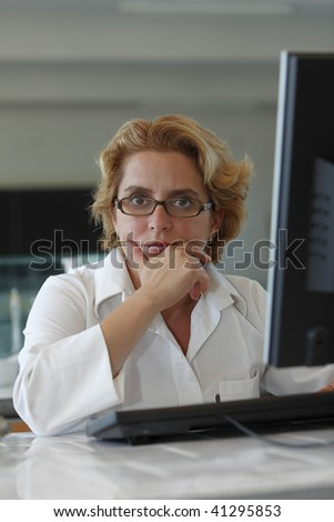 Female researcher thinking deeply at her workplace. - stock photo