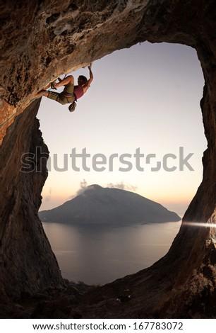 Female rock climber at sunset, Kalymnos Island, Greece  - stock photo