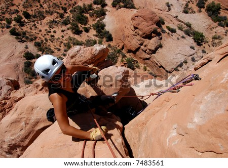 Female rock climber at the belay - stock photo