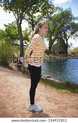 Female Runner Stretching outdoors - stock photo
