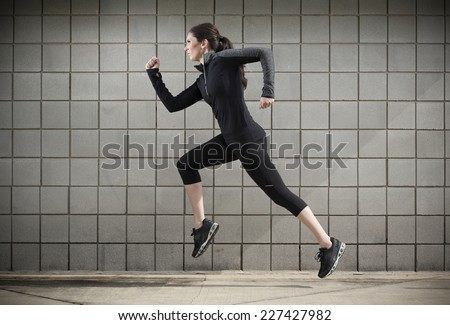 Female Running During a Workout - stock photo
