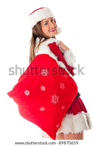 Female Santa carrying a sack with Christmas gifts ? isolated