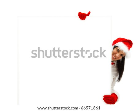 Female Santa with red hat and gloves behind a white billboard