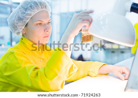 Female Scientific Research In Laboratory, Pharmaceutical factory - stock photo