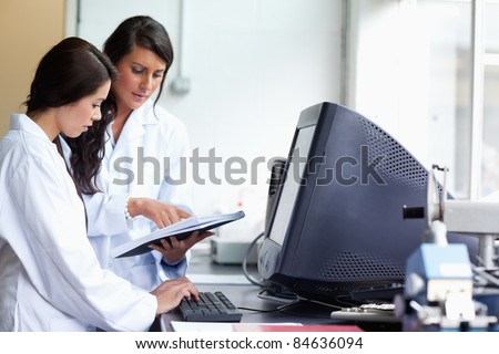 Female scientists comparing results in a laboratory