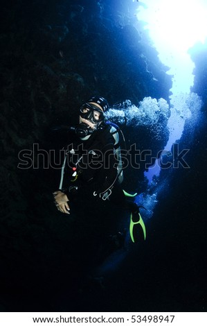 female scuba diver in underwater canyon