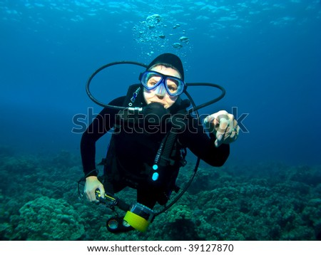 Female Scuba Diver swimming over a Reef in Kona Hawaii - stock photo