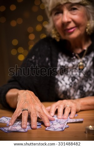 Female seer using tarot cards to foretell