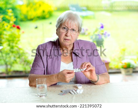 female senior with a lot of medicament  - stock photo