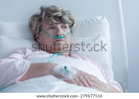 Female senior with nasal cannula staying in hospital - stock photo