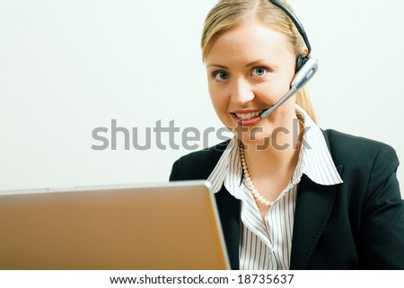 Female service worker at a call in help desk - stock photo