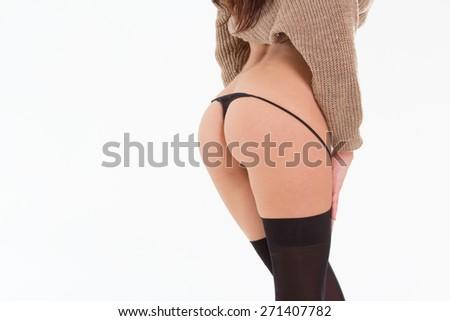 female sexy buttocks in black lingerie - stock photo
