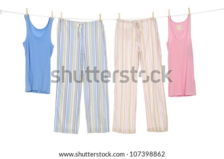 Female shirt and trousers clothespins on rope - stock photo