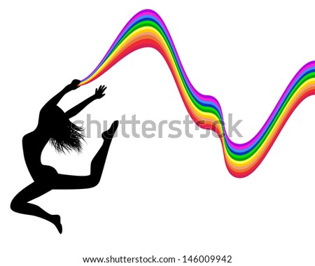 female silhouette jumping and holding a rainbow trail  - stock photo