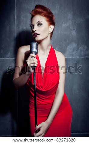 Female singer red dress; vintage mic