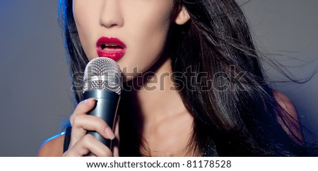 Female singing into mic