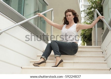 Female sitting on a staircase of a building