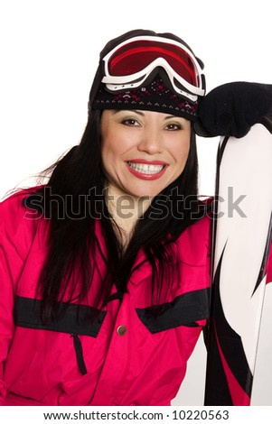 Female skier wearing ski gear casually leans on skis and smiles brightly.
