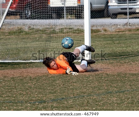 Female Soccer keeper makes the save - stock photo