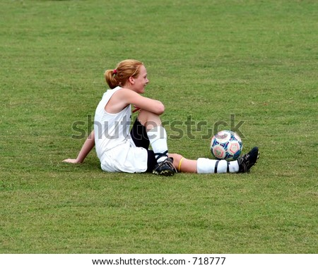 Female soccer players stretching before a game - stock photo