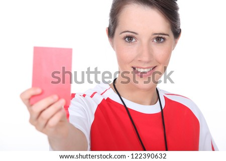 female soccer referee holding out red card - stock photo