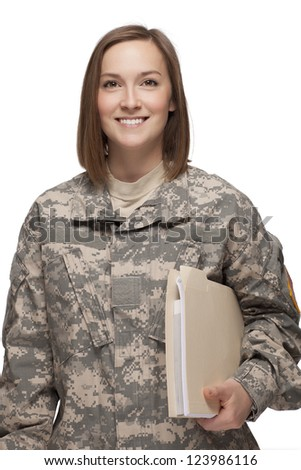 Female Soldier holding books - stock photo