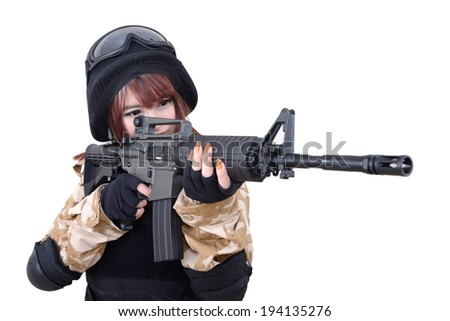 Female soldier in combat suit was aimed to the target.