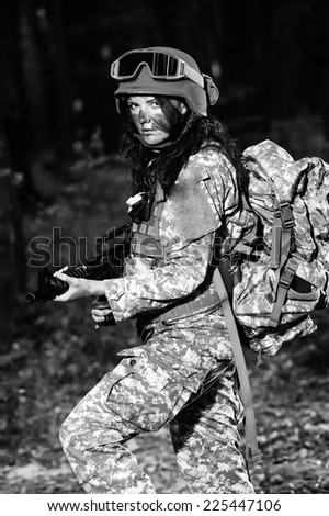 Female soldier in the forest. - stock photo