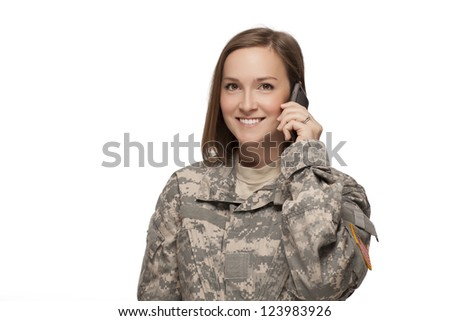 Female Soldier on her cell phone - stock photo