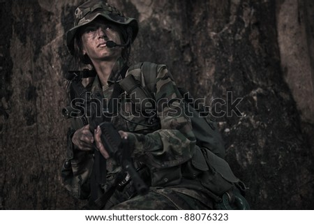 female soldier operating in the darkness of jungle - stock photo