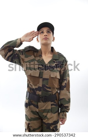 Female soldier saluting looking up against white background - stock photo