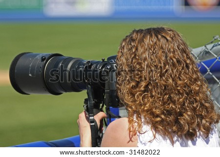 female sports photographer at work