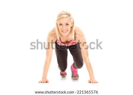 Female sprinter in starting position isolated on white background - stock photo