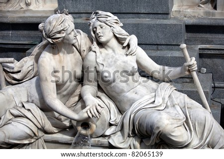 Female statues in the The Athena Fountain (Pallas-Athene-Brunnen) situated in front of the building of Austrian Parliament. - stock photo
