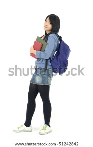 female student carrying notebooks over a white