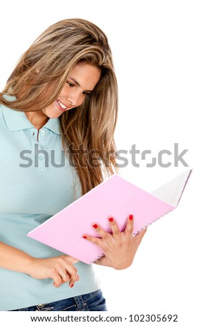 Female student holding a notebook - isolated over white - stock photo