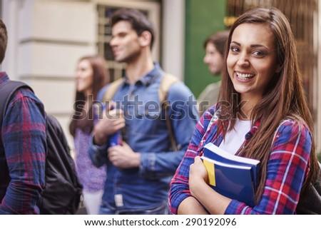 Female student holding her books - stock photo
