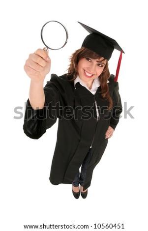 Female Student Holding Magnifying Glass - stock photo