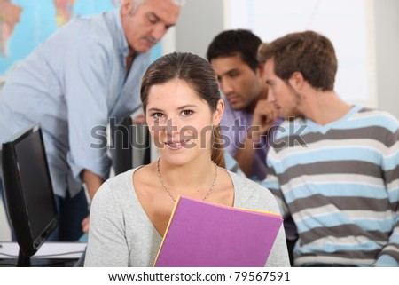Female student in a computer class - stock photo