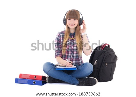 female student listening music and studying isolated on white background - stock photo