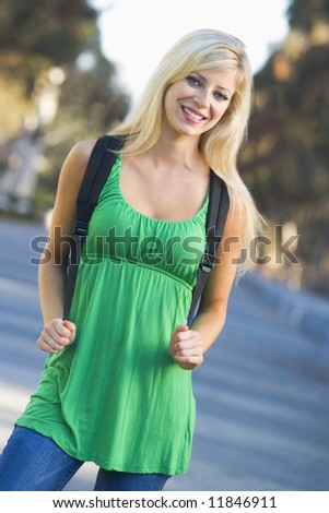 Female student off campus with rucksack - stock photo