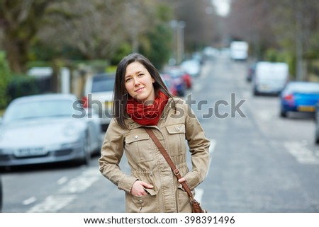 Female student shoot with blurred street as background - stock photo