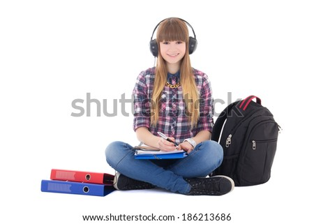 female student studying and listening music isolated on white background - stock photo